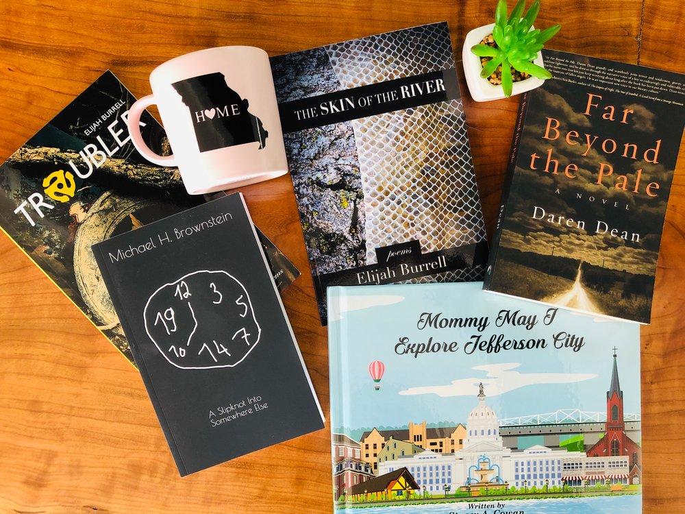 Books by Elijah Burrell, Michael Brownstein, Stacy Cowan, and Daren Dean