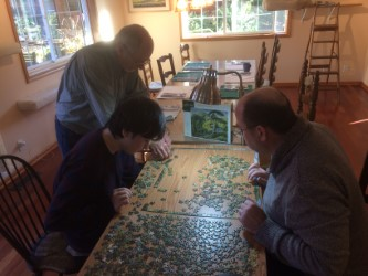 Thanksgiving Puzzle, a tradition.  From the left, Corwin Hansen, Michael Clough, Paul Hansen.