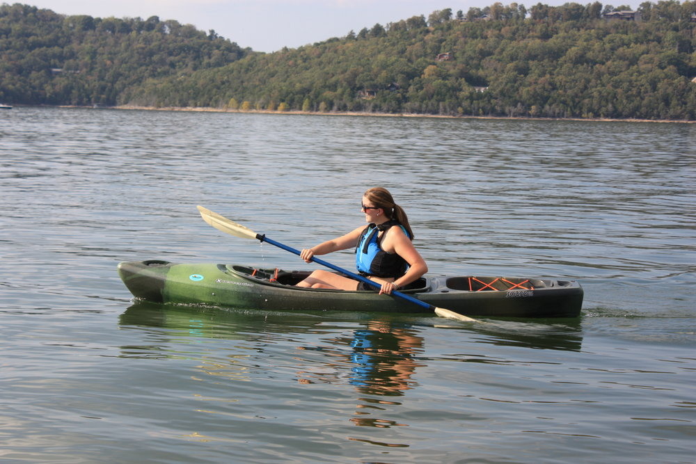 """Perception Sound - A more traditional sit-inside kayak with a modern design. Roomy, easy to paddle, the Sound stays relatively straight when paddling. Two built-in rod holders for the angler in your group. The boat features a large area to keep a cooler or gear in the rear storage area. Provides more protection from wind and waves than a sit-on-top. But if you do tip, it's harder to empty out the water!(Length: 10'6"""", Weight: 46 lbs, Capacity: 335 lbs)"""