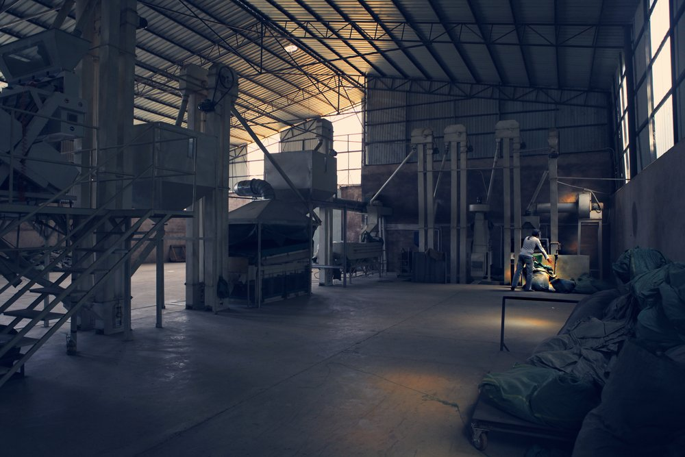 coffee Processing and bagging factory. ( In the photo: Tim, CEO of Yunnan Coffee Traders)