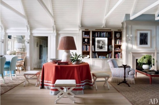 {Bold and red, this large skirted round table is a show stopper in this living space. From  architectualdigest.com .}