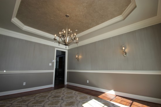 {AFTER. Ceiling painted with metallic finish to play off of walls and bounce light. Color selection by AFP Interiors, paint treatment by Deelite Design.}