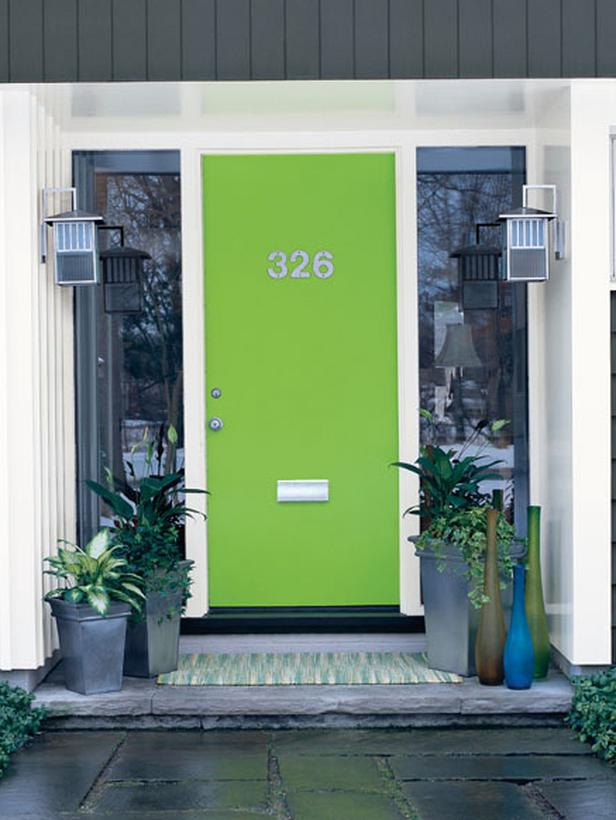 {A modern home deserves a cool shade of green in its front door.}