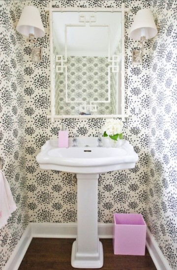 {This powder room wallpaper strikes a bit of fun against the traditional fixtures. Image from  Cute and Company .}