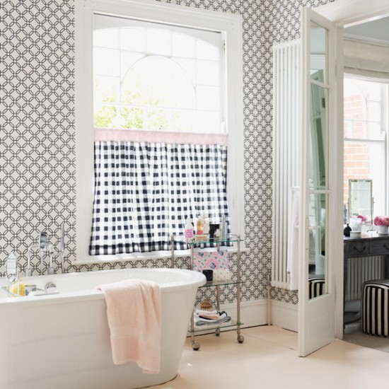{The geometric pattern on the bathroom wallpaper is timeless!}