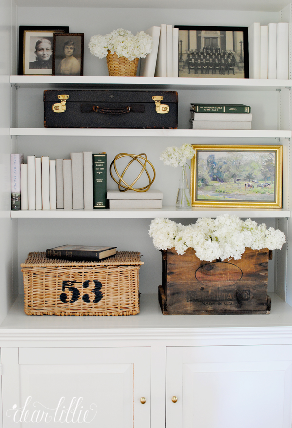 {The family keepsakes blend seamlessly here with the newer accessories and consignment store finds. From:  Dear Lillie .}