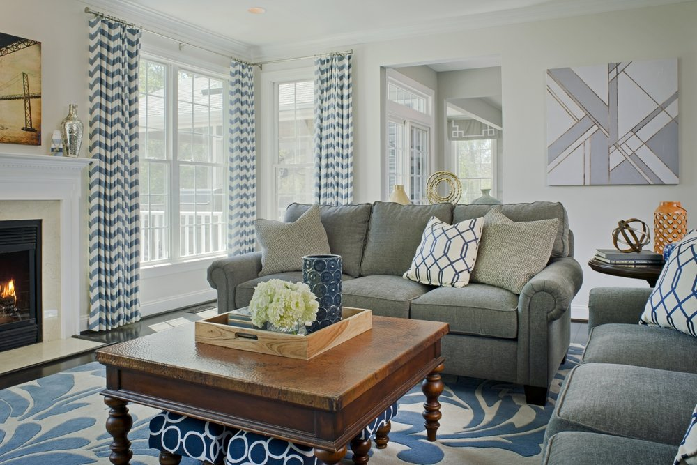 {Chevron curtains stacked just outside of the window frames creates the feeling of wide, wall-length windows. Design by  April Force Pardoe Interiors .}
