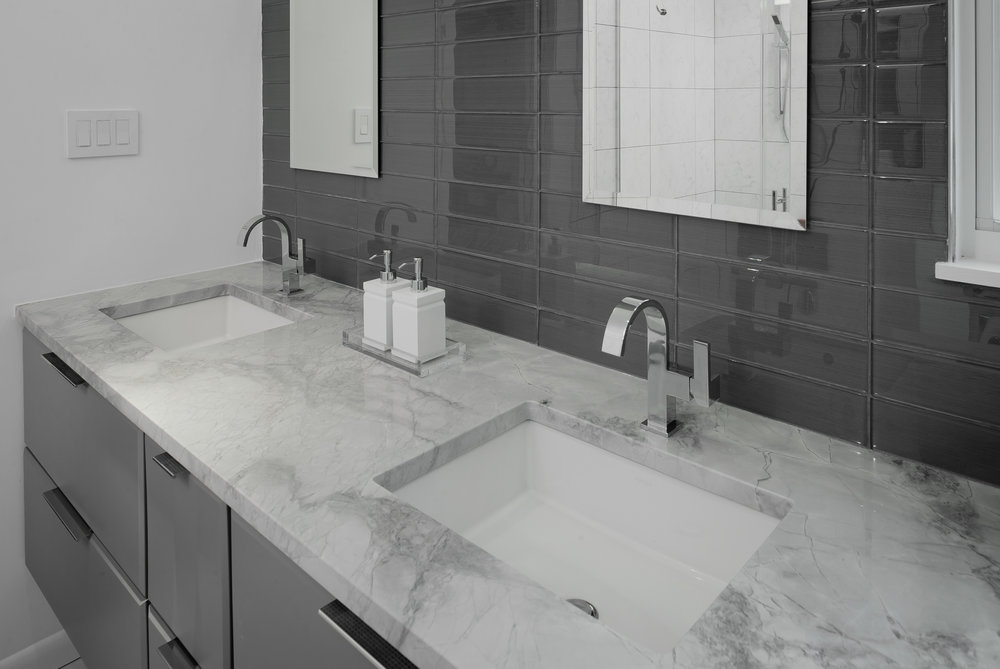 {Vanity with rectangle double sinks, sleek chrome faucets and drawers for great storage.}