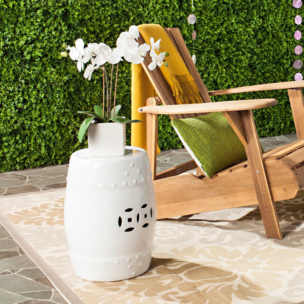 {Garden stools can quickly transform from a side table or plant stand to a seat, making it an excellent option if you love to entertain at your vacation home. From:  Savafieh .}
