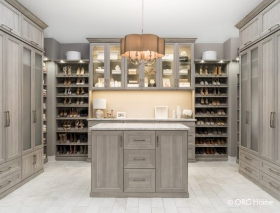 {Master bedroom closet system by  Cornerstone Closets .}