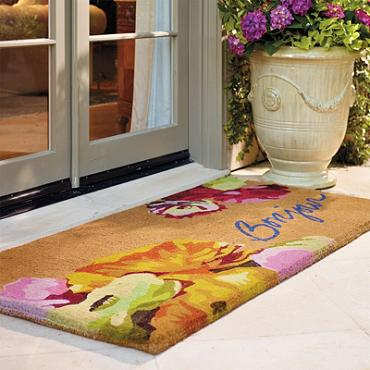 {Floral and pretty welcome mat from Frontgate.}