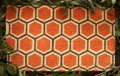 {Modern, bold honeycomb doormat, found on  houzz.com .}