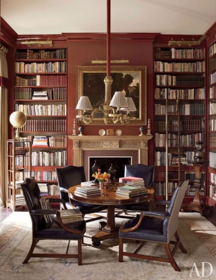 {A library in the living room is a great use of space for reading or conversation. From Architectural Digest.}