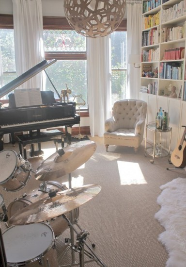 {Music anyone? A piano and drums in your living room turn it into an often-used music room! From Apartment Therapy.}