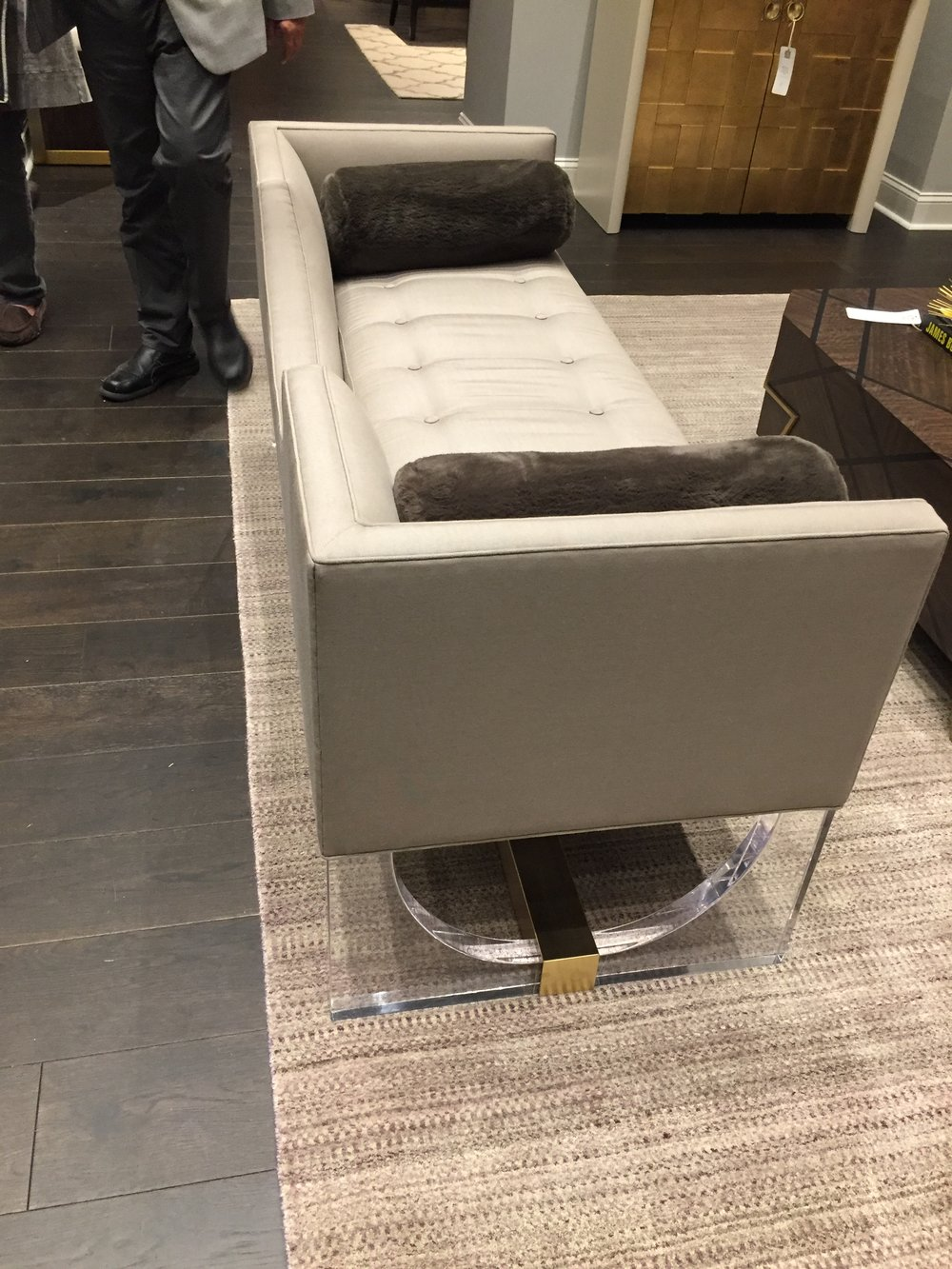 {This modern sofa is floating on an acrylic base. From  Fine Furniture Designs .}