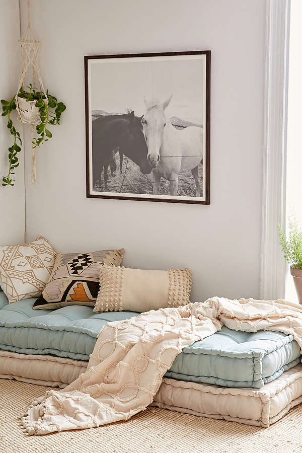 {A stack of overstuffed daybed cushions in your child's bedroom makes for both a cozy reading nook for them and a cushy sleeping space for their guest. From: Urban Outfitters .}