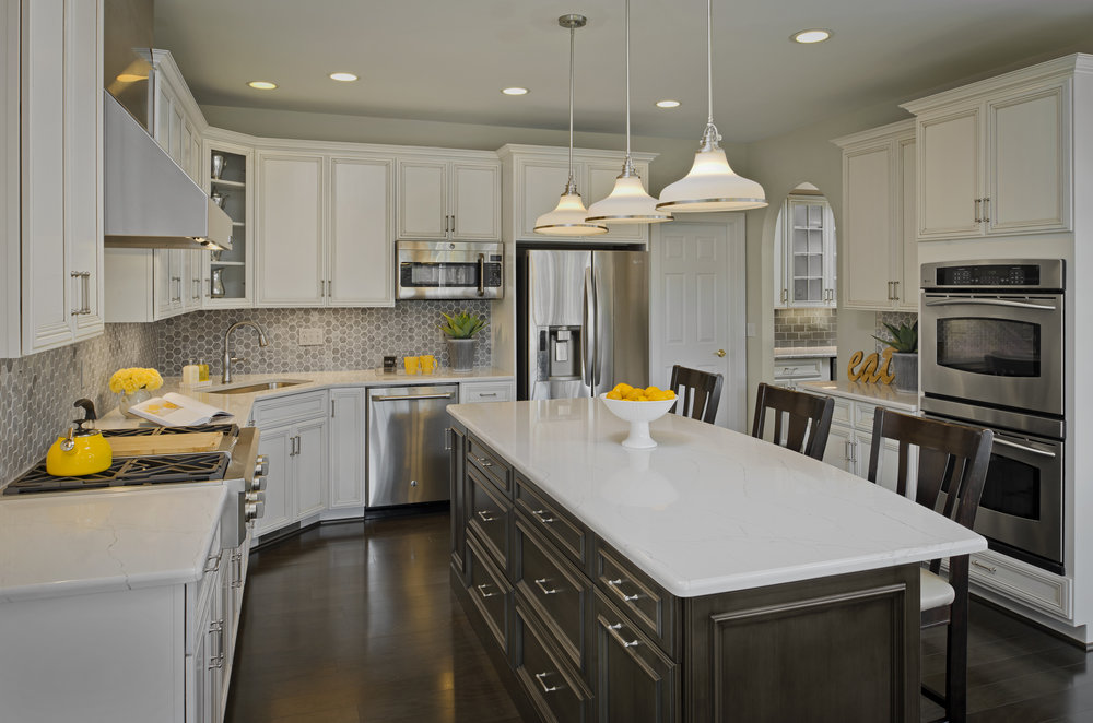 {Custom painted cabinets by  Lenehan Studios , Design by  April Force Pardoe Interiors .}