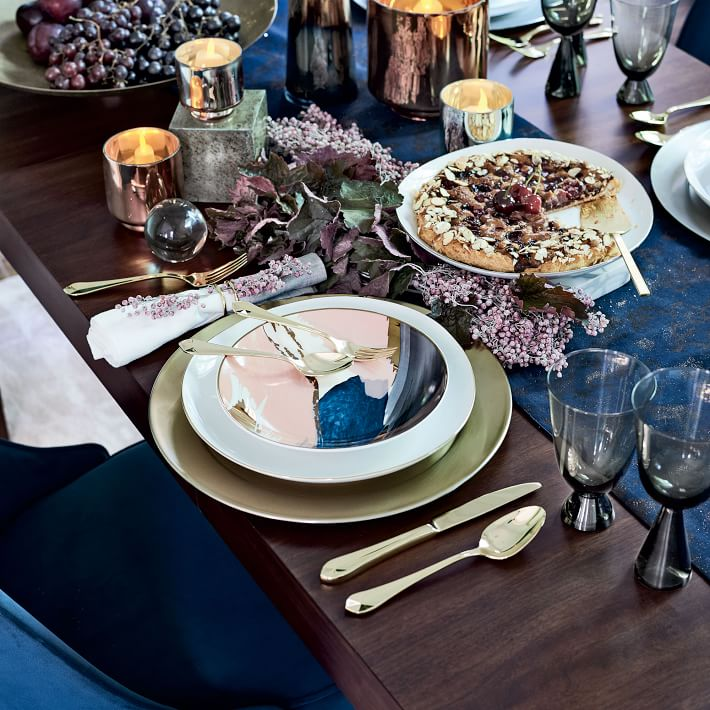 {This rich sugarplum, navy and gold color scheme is simply decadent. From:  West Elm .}