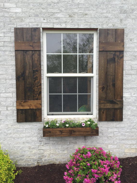 {The handmade cedar window box and matching stained shutters are a match made in rustic heaven. From: A Little Curb Appeal.}