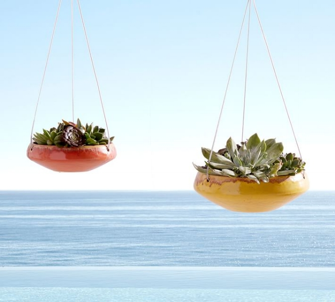 {These sleek, glazed hanging planters are anything but traditional. From: Pottery Barn.}