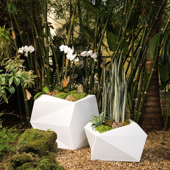 {Clean, crisp lines and simplistic design add an edge and high style to these Origami planters. From: West Elm.}