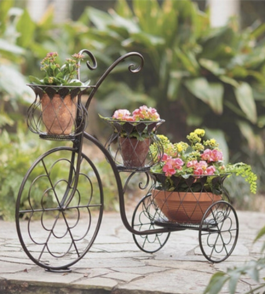 {Nothing says 'garden charm' more than sculpture planters. A unique ornamental piece, like this tricycle, adds a whimsical accent to your porch or patio. From: Wayfair.}