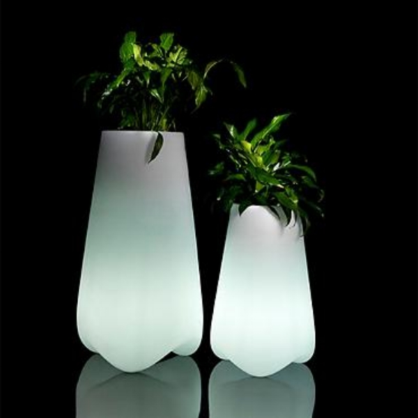 {This minimalist tapered planter has a truly unique feature – an LED light in the base! Doing double duty, it is perfect for after-dark outdoor entertaining. From: Frontgate.}