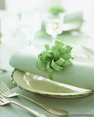 {A pretty bow around a napkin adds a pop to your table settings. From:  Martha Stewart .}