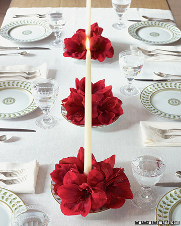 {Simple and elegant, these candle and floral centerpieces are great for any holiday table. From  Martha Stewart .}