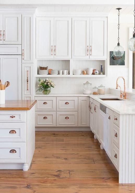 {Rose gold looks superbly sophisticated against a neutral backdrop like crisp, white cabinets and adds a subtle warmth, too! From:  Century Hardware .}