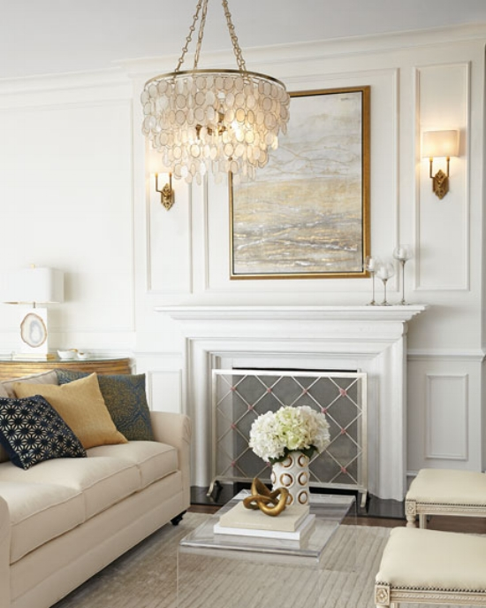 {I can picture all too clearly this living room afterdark, fire crackling in the hearth and an inviting glow from the sconces and chandelier. and From: Neiman Marcus.}