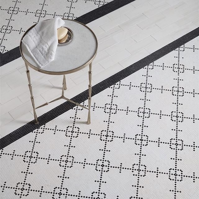A super subtle diamond mosaic, this art deco-esque tile is a step outside of the traditional check or brick pattern box. From:  Jeffrey Court .}