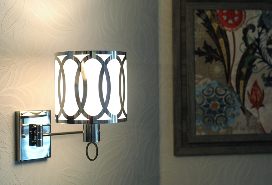 {This swing arm sconce is both functional and decorative lighting. Design by  April Force Pardoe Interiors .}