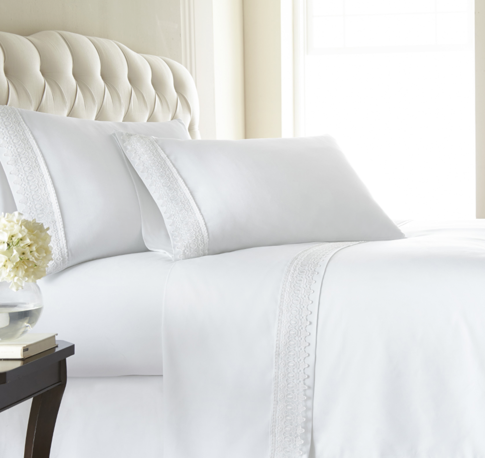 {Crisp white sheets say welcome, stay – but not too long! From  Overstock.com .}