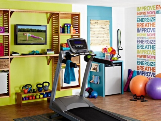 {A small home gym is a perfect fit for an empty bedroom. From  Digsdigs.com }