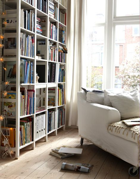 {Natural light, bookshelves and a comfortable chair create a wonderful reading room. From  Spiritvines.com }