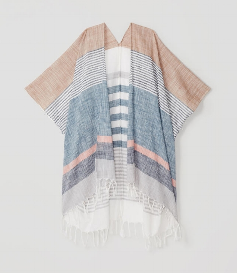 {Keeping it all in the same color family, this fringed poncho keeps the palette soft and subdued. From: Loft .}