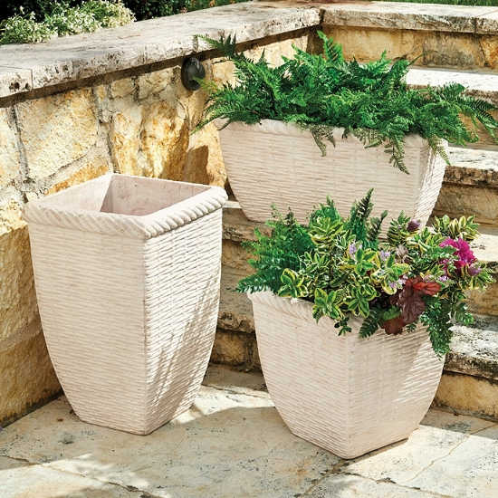 {Clustering some classic planters together are not only a foolproof front entrance design tip, but the neutrals will help the flowers' colors pop. From:  Ballard Designs .}