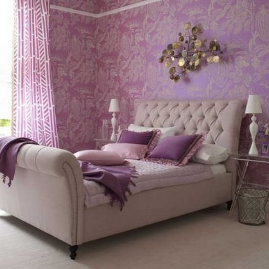 {A soothing lavender bedroom with cream accents.}