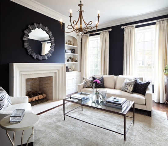 {Navy blue walls with high contrast upholstery and details make for a very clean and inviting space. From:  Huffington Post .}
