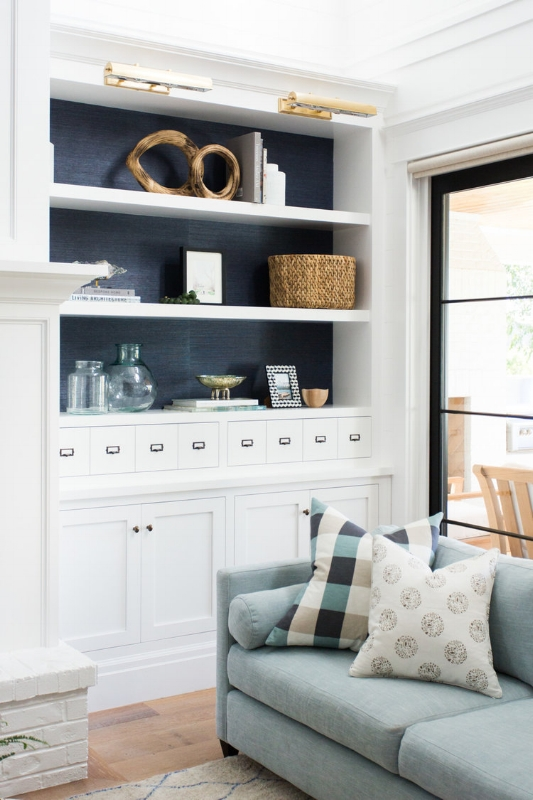 {I adore the peekaboo navy detail on the back of this built in. From:  Studio McGee .}
