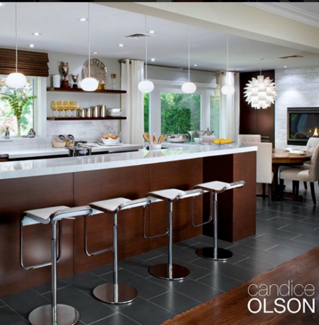 {Coordinated, but not matching, kitchen lighting. Design by  Candice Olson .}