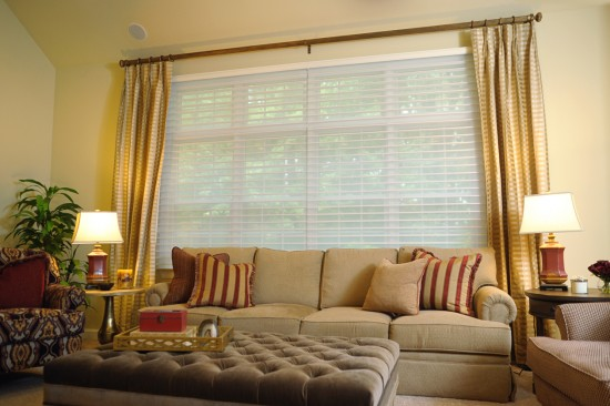 {Savannah shades shown filtering light. They can also blackout a room for a restful sleep. Design by  April Force Pardoe Interiors. }