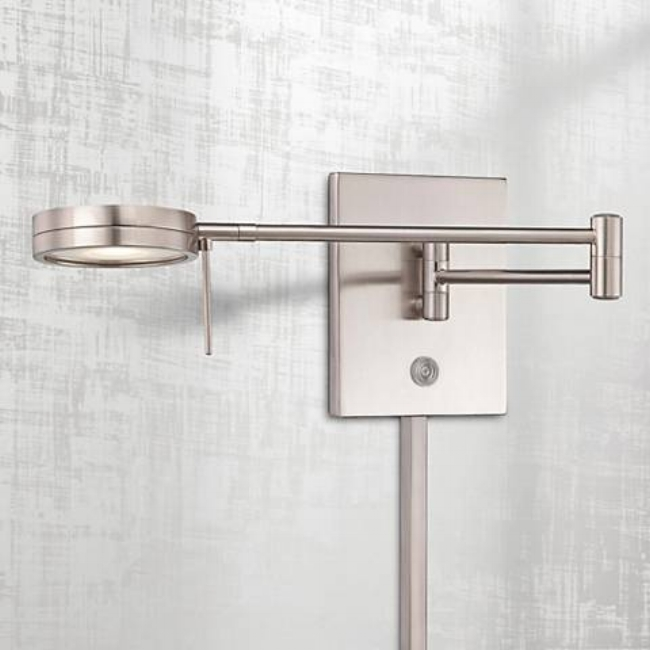 {This George Kovacs swing arm light fixture has a low-profile, modern look and can be plugged in. From:  Lamps Plus .}