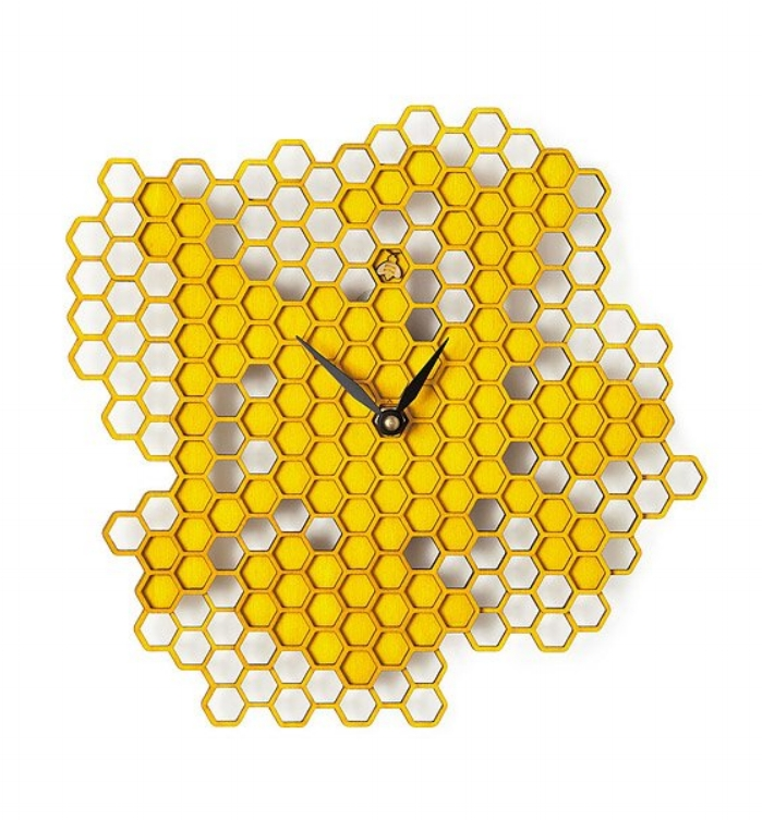 {This cheerful wall clock will be a great addition to your home and keep you prompt! From Uncommon Goods.}