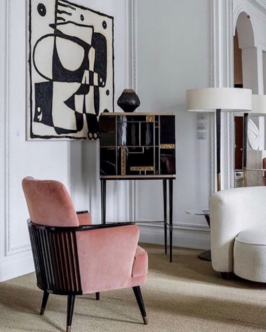 {Powder pink upholstery pops oh so perfectly in this high contrast living space. From:  Elle Decor .}
