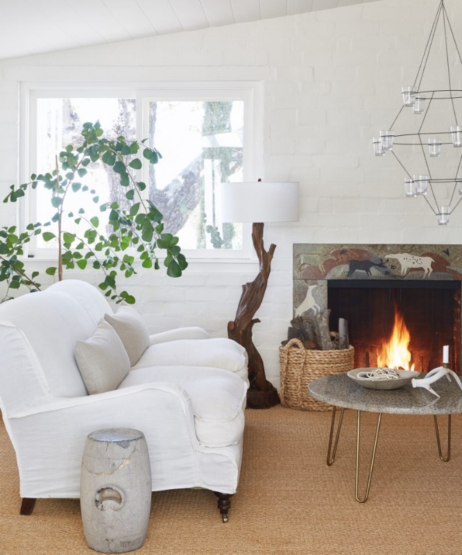 {A lovely ivory room with great natural light and earthy accents. Design by  Victoria Pearson .}