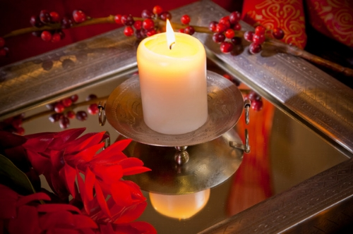 {Add some oomph to your candles'glow with mirrored trays and containers.From:  She Knows .}