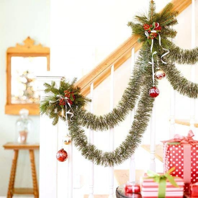{Swags of green tinsel garland enhance this banister. From:  Better Homes & Gardens .}