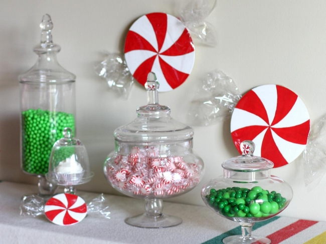 {For a youthful – and snacking friendly– approach, fill different sized containers and jar with color coordinating candies.From:  DIY Network .}